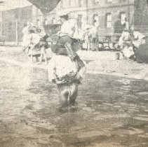 Image of 2011.79 - Kids Standing in Flood Water