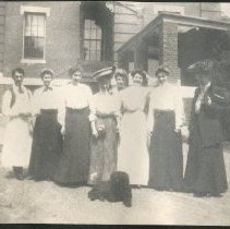 Image of 2011.79 - Women and Man in Front of Building