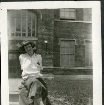 Image of 2011.86 - Photograph of Woman in Front of Building