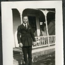 Image of 2011.86 - Photograph of Man In Front of House