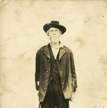 Image of 1994.19 - Andrew Taylor Still Postcard Standing with Walking Stick in Right Hand 1915