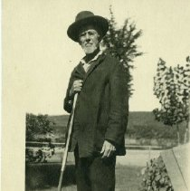 Image of 2012.17 - Andrew Taylor Still Black & White Postcard With Cane in Front of Lake 1917