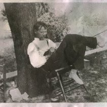 Image of 1984.952 - Photo of Andrew Taylor Still on Millard Farm in Chair Writing