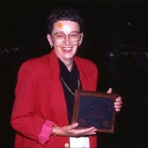 Image of 2012.19 - Woman Holding Plaque