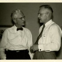 Image of 1976.155 - Ralph Lickleder and unidentified man talking 1952 Oct