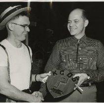 Image of Harry T. Still jr receiving Golden P faculty plaque 1954