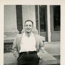 Image of 1983.829 - Unidentified man leaning on stair ledge during Sadie Hawkins 1948