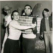 Image of 1983.829 - Man in drag with man in toilet costume at Sadie Hawkins dance 1950 Nov