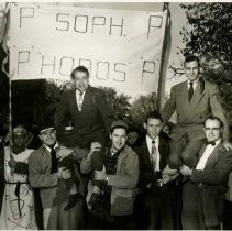 Image of 1983.829 - George E. Snyder and Carl B. Umanzio on shoulders of students during Sadie Hawkins 1953