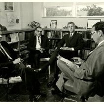 Image of 1996.17 - Price Thomas, Francis W. Charnock, Elliott Hix, and Irvin M. Korr sitting in office