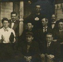 Image of John Pickhardt with men on porch ca. 1914