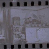 Image of 2007.63 - Film negative of Doris reading in bunk bed