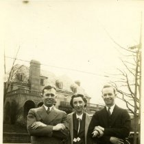 Image of 2006.46 - Woman and two men in front of large brick building