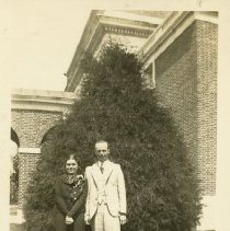 Image of 2006.46 - Man and woman in front of bush near Memorial Union walkway