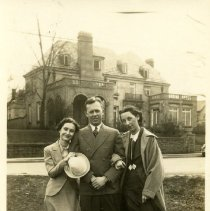 Image of 2006.46 - Two women and a man in front of brick building