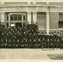 Image of 1978.230 - Kirksville College of Osteopathy & Surgery graduates in front of building in caps & gowns