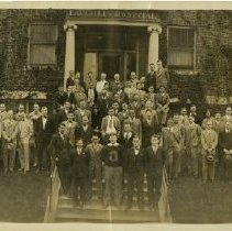 Image of KCOS Class of 1929 in front of Laughlin Hospital