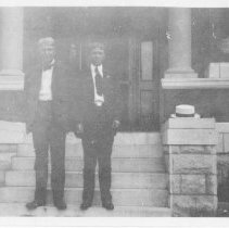 Image of 1984.978 - Charles E. Sr. and Herman T. Still standing outside on porch of home