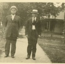 Image of 1984.978 - Harry Mix and Herman Taylor Still standing on sidewalk