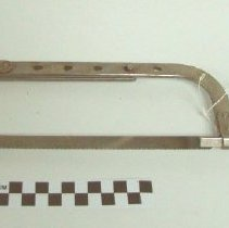 Image of 1983.800 - Dark wooden handled silver metal hand saw