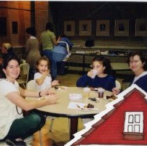 Image of 2011.98 - Two SAA Members with Children at Progressive Dinner