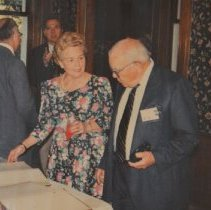 Image of 2011.50 - Man and Woman looking at Books at Atlas Club Founder's Day Reception