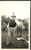 Image of Dr. Robert Palmer & George Scott golfing - Print, Photographic