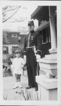 Image of Child with Uniformed Man - Print, Photographic