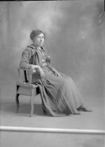 Image of Portrait of Woman in Chair - Print, Photographic