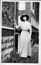Image of Lady by House - Print, Photographic