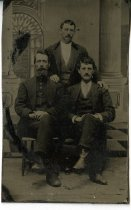 Image of Two Men Sitting One Standing - Print, Photographic