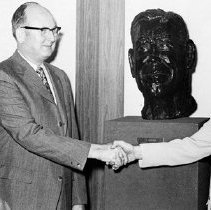 Image of Sendra presents bust of CEW to CEO Dave Garrett and Chairman Tom Beebe