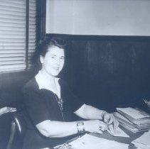 Image of Catherine FitzGerald wearing Delta ID badge on wrist, c. 1942