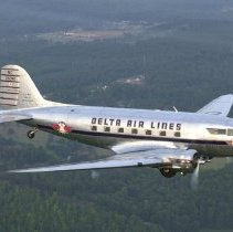 Image of Delta Douglas DC-3 Ship 41 in flight, 1999