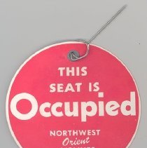 Image of Northwest Orient Seat Occupied Tag - 09/1953