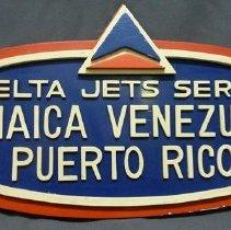 Image of Delta Jets Serve Jamaica, Venezuela, Puerto Rico Sign, 1960s