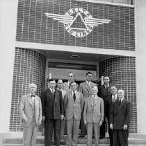 Image of 1947 logo sign on Executive Bldg with Delta Board of Directors