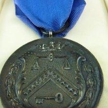 Image of C.E. Woolman's U.S. Treasury Medal, side 2