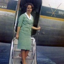 Image of Southern Airways Stewardess Sharron Stine on DC-3 Airstair, ca. 1965