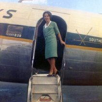 Image of Southern Airways Stewardess Sharron Stine on DC-3 Airstair - ca. 1965