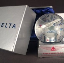 Image of 75 Years of Delta Flight Attendants Snow Globe - 2015