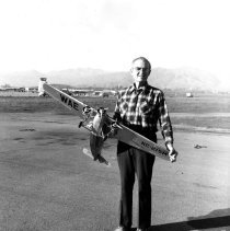 Image of Western Air Express Fokker F-10 model with builder Eugene Clay, ca. 1975