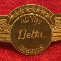 Image of C.E. Woolman's 40-Year Service Pin