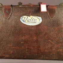 Image of C.E. Woolman's Suitcase - ca. 1948-1953