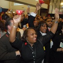 Image of Delta employees at ATL watch live feed NYSE Opening Bell Ceremony, 5/3/2007