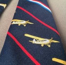 Image of Delta 50th Anniversary Commemorative Necktie, Travel Air aircraft detail