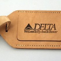 Image of Delta We Love To Fly And It Shows Bag Tag - ca. 1987-1993