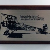 Image of Delta 50th Anniversary Plaque from Chicago Tribune - 1979