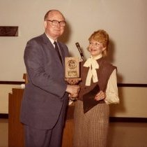 Image of Dave Garrett Presenting Project 767 Award to Jean Owens - ca. 1982