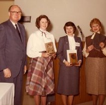 Image of Dave Garrett Presenting Project 767 Awards to Three Flight Attendants - ca. 1982